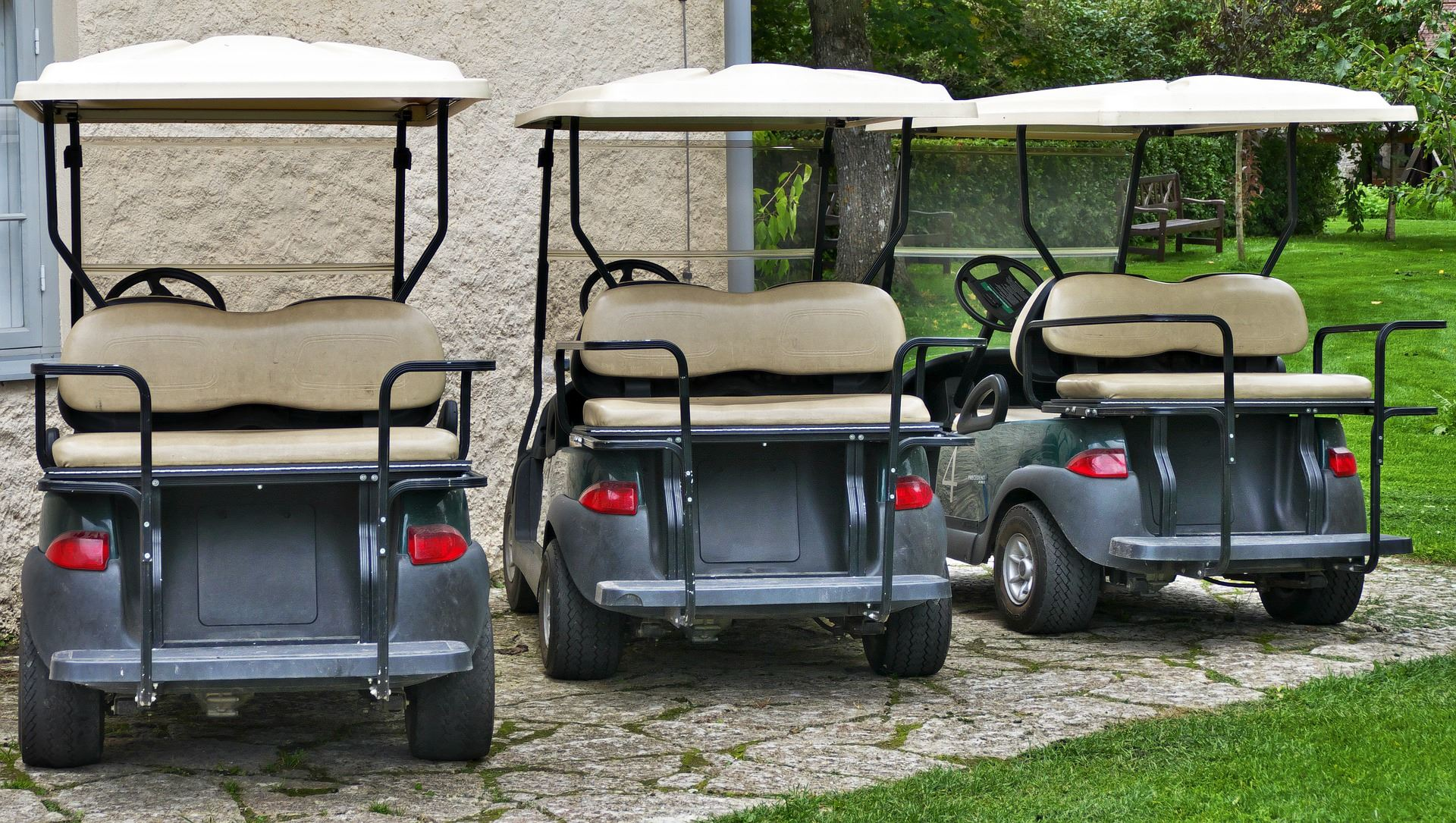 Three golf carts lined up